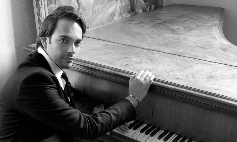 The pianist and composer Christophe Diès sitting at the piano